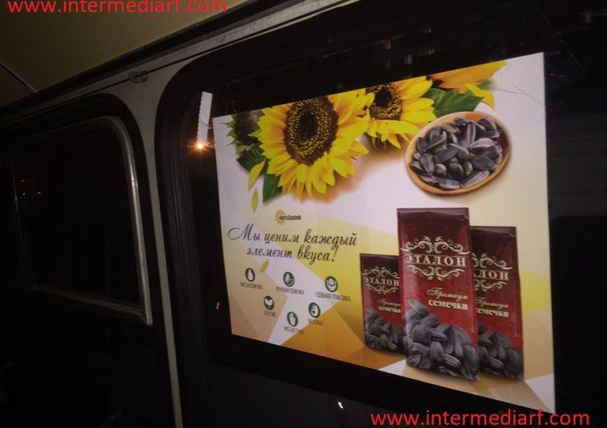 реклама семечек Богучарские ООО «Агро-Спутник» на стикерах формата А3 в салоне общественноготранспорта в городеЧеркесск (1)