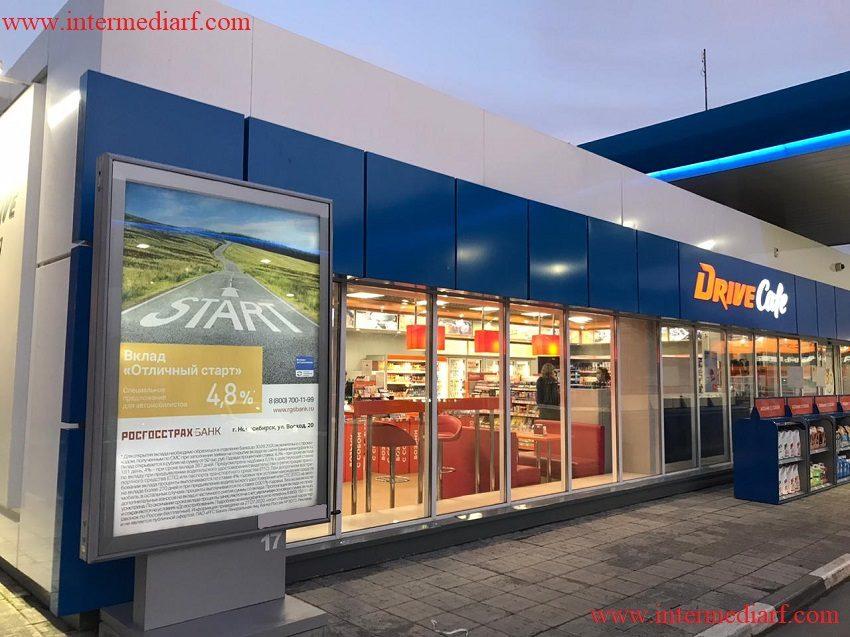 Стартовала рекламная кампаниябанка Росгосстрах банк на скроллерах на АЗС в городе Новосибирск (4)